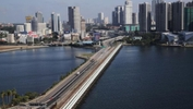 Malaysia, Singapore to Work Together to  'Progressively Restore' Cross-Border Travel