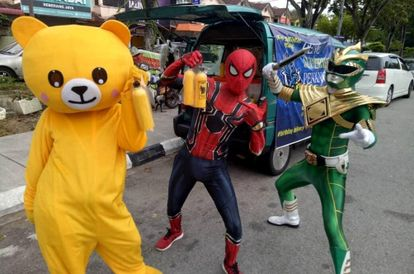 Retrenched, Penang Man Teams Up With Friends And Turn Into Superheroes Selling Corn Juice