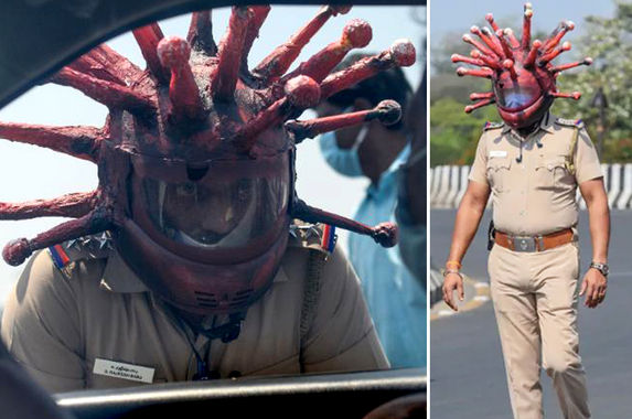 indian-police-officer-wears-coronavirus-helmet-to-scare-people-from-coming-out