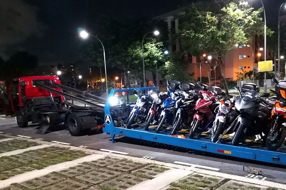 5-000-motorcycles-cars-towed-back-to-malaysia-because-it-s-too-expensive-to-keep-them-in-singapore