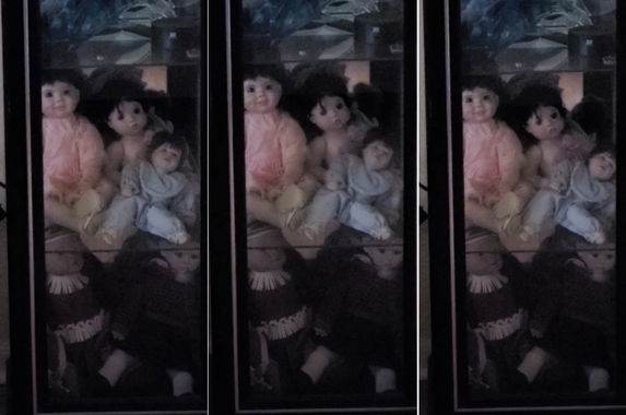 video-man-films-wife-s-haunted-dolls-moving-by-themselves-in-glass-cabinet