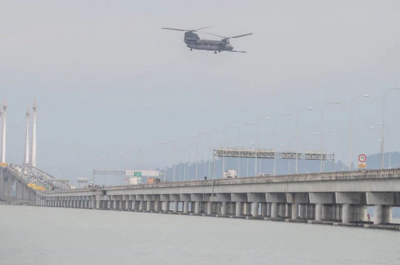 what-was-a-helicopter-built-in-the-1950s-doing-flying-above-the-penang-bridge