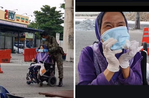 myhero-malaysian-soldier-captured-on-video-helping-lone-disabled-woman-put-on-mask-and-gloves