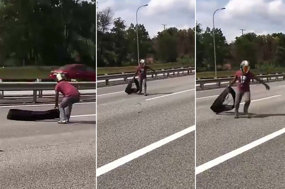 malaysian-motorist-risks-his-life-to-pick-up-debris-on-the-highway