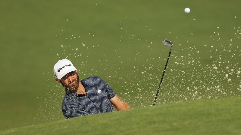 The Masters: Johnson's lead halved at midway point of final round, Woods endures nightmare