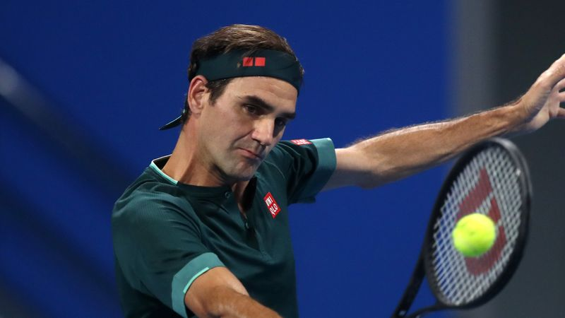 Federer marks return by winning mini-epic with friend Evans in Doha